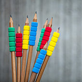 Row of color pencils on grey  background.Studio shot — Stock Photo