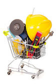 Shopping cart full of construction tools, isolated on white back — Foto de Stock