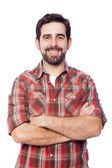 Smiling young casual man with arms crossed, isolated on white ba — Stock Photo