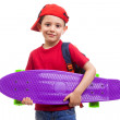 Schoolkid standing with skateboard and backpack — Stock Photo #78165280