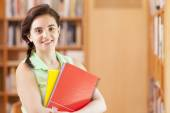 Student standing with notebooks — Stock Photo