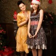 Portrait of two young woman posing at New Year eve. — Stock Photo #59746149