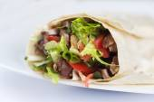 Tortilla with a delicious grilled meat and fresh mixed salad — Stock Photo