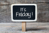 Wooden background with text  It's Friday — Stock Photo