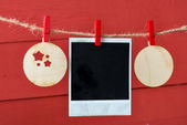 Old pictures on wood background with Christmas decoration. — Stock Photo