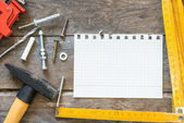Construction tools and notebook — Stockfoto