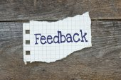 Feedback written on the paper — Stock Photo