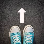 Male sneakers with drawn direction arrow — Stock Photo