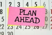 The phrase Plan Ahead written on sticky paper — ストック写真