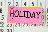 The word Holiday written on sticky note paper — Stock Photo