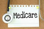 Medicare handwritten on paper note — Stock Photo
