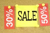 Cork board with sale percent's notes — Stock Photo