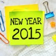 Text new year 2015 on the short note — Stock Photo #53480511