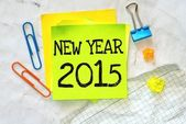 Text new year 2015 on the short note — Stock Photo