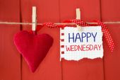 Happy Wednesday on instant paper and small red heart — Stock Photo
