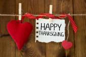 Happy thanksgiving message written on a paper hanging on the clothesline — Stock Photo