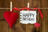 Happy birthday message written on a paper hanging on the clothesline — Stock Photo