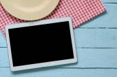 Tablet pc on wooden table — Stock Photo