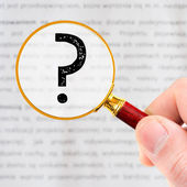 Magnifying glass with question mark — Stock Photo