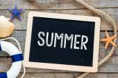 Marine items and blackboard with text Summer — Stock Photo