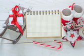 Notebook and Christmas decorations — Stok fotoğraf