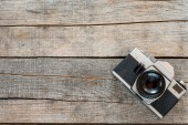 Old camera and on wooden table — Stock Photo