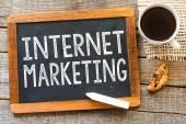 Internet marketing handwritten with white chalk — Stock Photo