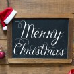Постер, плакат: Merry Christmas inscription on chalk blackboard