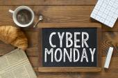 Cyber monday  handwritten with white chalk — Stock Photo