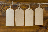 Price tags on wooden plank background — Stock Photo