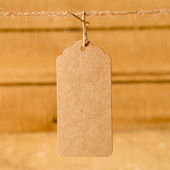 Price tag on wooden plank background — Stock Photo