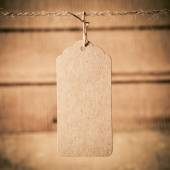 Price tag on wooden plank background — Stok fotoğraf