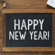 Happy New Year! handwritten with white chalk — Stock Photo #55428879