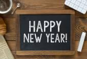 Happy New Year! handwritten with white chalk — Stock Photo