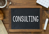 Consulting handwritten with white chalk — Stock Photo