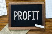 Profit Handwritten with white chalk on a blackboard — Stock Photo