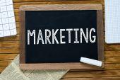 Marketing Handwritten with white chalk on a blackboard — Stock Photo
