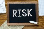 Risk Handwritten with white chalk on a blackboard — Stock Photo