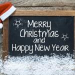 Christmas inscription on blackboard — Stock Photo #57857375
