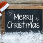 Christmas inscription on blackboard — Stock Photo #57857389