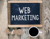 Web Marketing sign on blackboard — Stockfoto