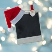Old photo frame with Santa hat — Stock Photo