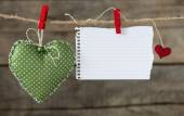 Hearts  with paper on rope — Stock Photo