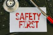 Safety first sign and stethoscope. — Stock Photo
