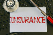 Insurance sign and stethoscope — Stock Photo