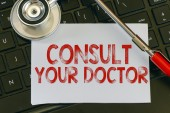 Consult your doctor sign — Stock Photo