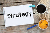 Notebook with strategy sign — Stock Photo