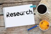 Notebook with research sign — Stock Photo
