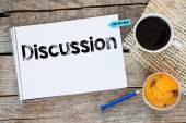 Notebook with discussion sign — Stock Photo