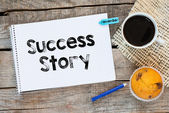 Notebook with  success story sign — Stock Photo